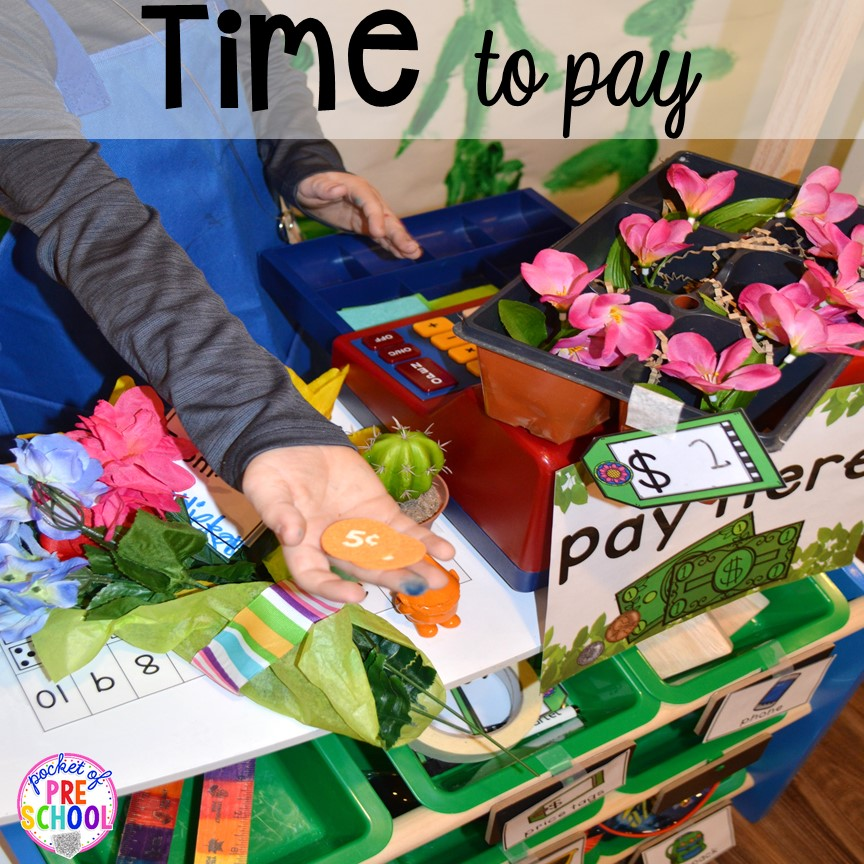 Time to pay! Flower Shop Dramatic Play for a spring theme, Mother's Day theme, or summer theme when everything is growing and blooming. Any preschool, pre=k, and kindergarten kiddos will LOVE it (and learn a ton too). #flowershop #gardenshop #presschool #prek #dramaticplay
