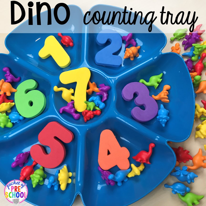 Dinosaur counting tray plus tons of dinosaur themed activities & centers your preschool, pre-k, and kindergarten students will love! #preschool #pocketofpreschool #dinosaurtheme