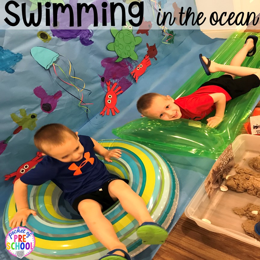 Pretend to swim at the beach. Set up a Beach in the dramatic play or pretend center and embed a ton of math, literacy, and STEM into their play! #dramaticplay #pretendplay #preschool #prek #beachtheme #oceantheme