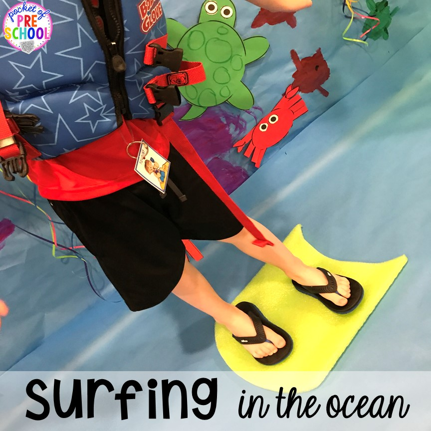 Pretend to surf. Set up a Beach in the dramatic play or pretend center and embed a ton of math, literacy, and STEM into their play! #dramaticplay #pretendplay #preschool #prek #beachtheme #oceantheme