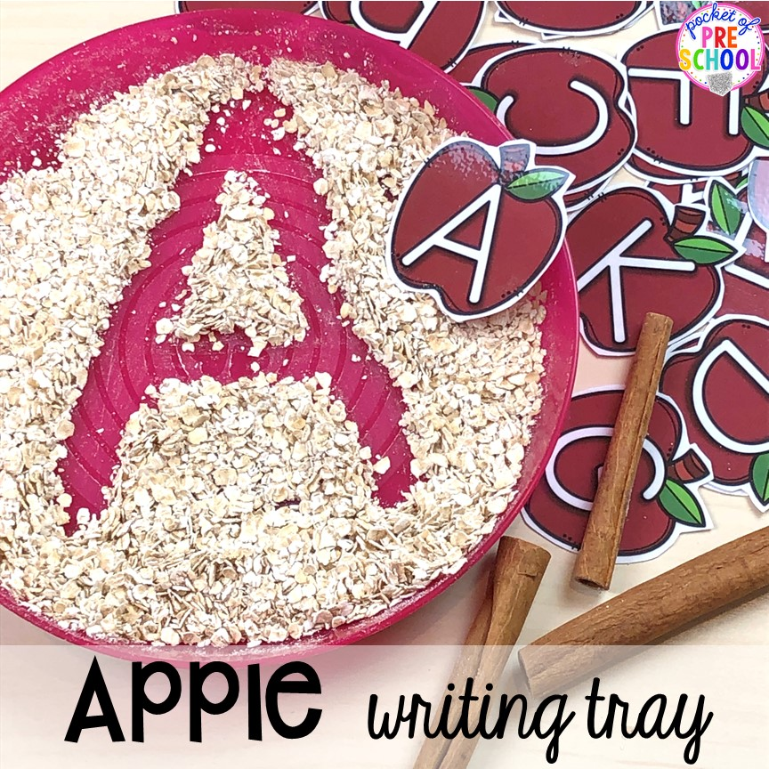 Apple sensory writing tray plus more apple theme activities and centers perfect for preschool, pre-k, and kindergarten. #appletheme #preschool #prek #appleactivities