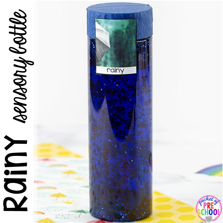 Rainy!Weather sensory bottles is af fun way to explore the weather inside and FREE weather photo labels. #weathertheme #preschool #prek #toddler #sensorybottles