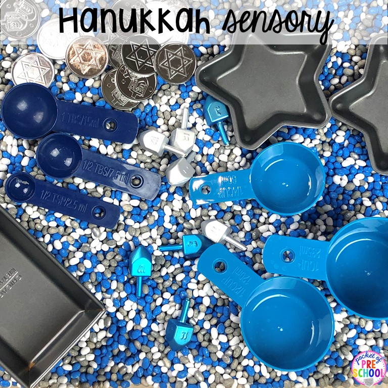 Hanukkah sesnory table plus more sensory tables for every holiday with various sensory fillers and sensory tools that incorperate math, literacy, and science into play. #sensorytable #sensorybin #sensoryplay #preschool #prek