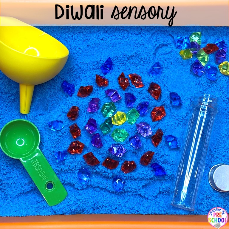 Diwali sesnory table plus more sensory tables for every holiday with various sensory fillers and sensory tools that incorperate math, literacy, and science into play. #sensorytable #sensorybin #sensoryplay #preschool #prek