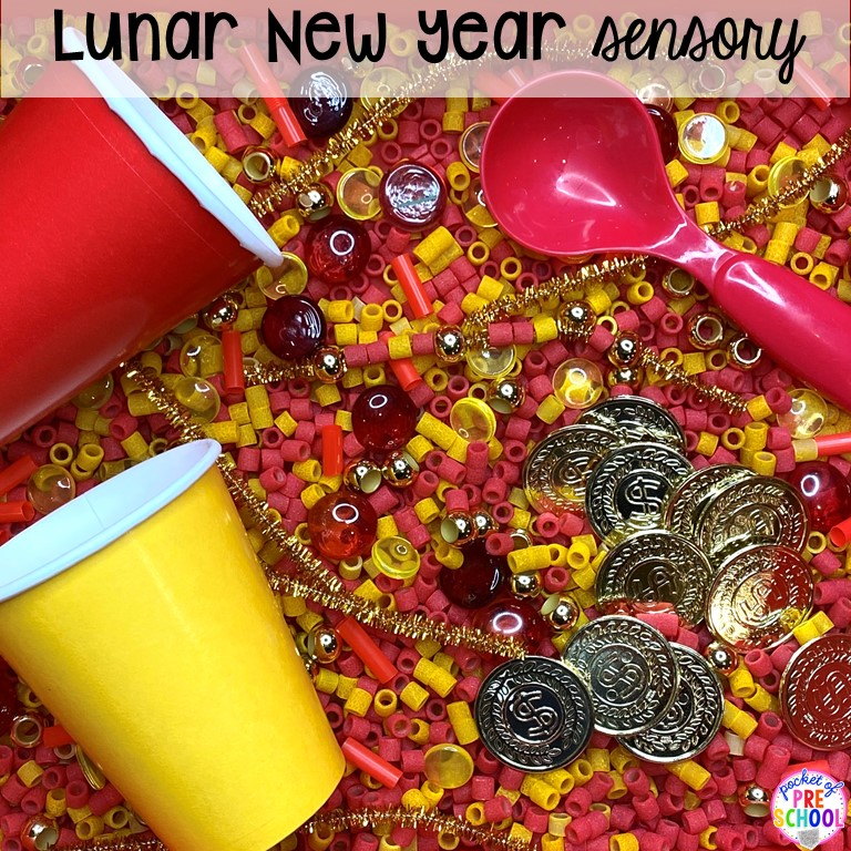 Lunar New Year sensory table plus more holiday sensory tables for every holiday with various sensory fillers and sensory tools that incorperate math, literacy, and science into play. #sensorytable #sensorybin #sensoryplay #preschool #prek